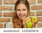 teenager with long hair holds... | Shutterstock . vector #1252005676