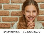 teenage girl with long hair... | Shutterstock . vector #1252005679