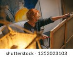 artist working on paint | Shutterstock . vector #1252023103
