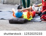 first aid after work accident   Shutterstock . vector #1252025233