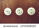 analog light switch on wooden... | Shutterstock . vector #1252058269