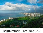 rainbow and rainy clouds over... | Shutterstock . vector #1252066273