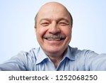 elderly man with a mustache... | Shutterstock . vector #1252068250