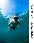 young man free diving and...   Shutterstock . vector #125208593