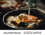 clear chicken broth with pieces ... | Shutterstock . vector #1252116910