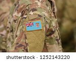 flag of fiji on soldiers arm.... | Shutterstock . vector #1252143220