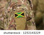 flag of jamaica on soldier arm. ... | Shutterstock . vector #1252143229