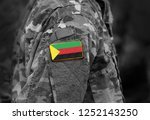 flag of azawad on soldiers arm. ... | Shutterstock . vector #1252143250