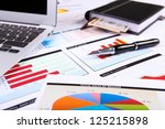 financial paper charts and... | Shutterstock . vector #125215898