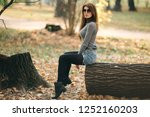 photo of woman sitting on tree... | Shutterstock . vector #1252160203
