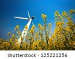 a big wind turbine in rapeseed... | Shutterstock . vector #125221256