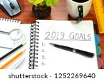 2019 new year goals written on... | Shutterstock . vector #1252269640