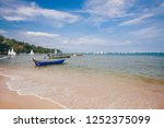 Small photo of Phuket, Thailand – November 25, 2018: Scenic view of Bang Tao Bay with traditional longtail boats parking on the beach with breaking wave and nice blue sky, Bang Tao Beach, Phuket, Thailand.