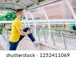 male jogger doing stretching...   Shutterstock . vector #1252411069