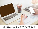 man holding phone and writing... | Shutterstock . vector #1252422349