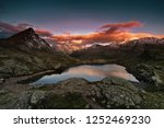 sunset in the mountains. small... | Shutterstock . vector #1252469230