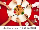 hands holding chopsticks ready... | Shutterstock . vector #1252565320