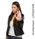 young woman showing stop hand... | Shutterstock . vector #125262248