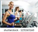 young women running on a... | Shutterstock . vector #125263160