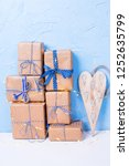 stack of wrapped boxes with... | Shutterstock . vector #1252635799