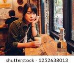 asian woman drinking coffee in  ... | Shutterstock . vector #1252638013