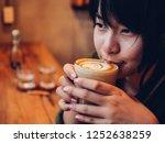 asian woman drinking coffee in  ... | Shutterstock . vector #1252638259