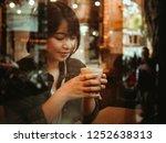 asian woman drinking coffee in  ... | Shutterstock . vector #1252638313