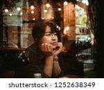 asian woman drinking coffee in  ... | Shutterstock . vector #1252638349