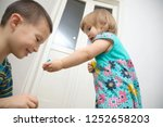 children playing at home.... | Shutterstock . vector #1252658203