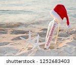 santa hat on message in a... | Shutterstock . vector #1252683403
