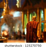 YANGOON, MYANMAR - NOVEMBER 2 ; Devoted people are praying at the shwedagon pagoda on Nov. 5, 2011 Yangoon, Myanmar.This Shwedagon in Yangoon is the most holy and biggest of the whole country - stock photo