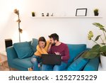 cute happy couple sitting on... | Shutterstock . vector #1252725229