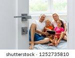 opened white door to modern... | Shutterstock . vector #1252735810