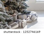 new year's gold gifts lie under ... | Shutterstock . vector #1252746169
