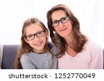 portrait of happy mother and... | Shutterstock . vector #1252770049