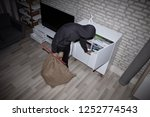 elevated view of thief with... | Shutterstock . vector #1252774543