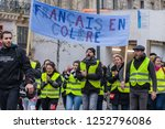 "Small photo of Place de la Republique, Paris, France - December 08, 2018 : Demonstrators with yellow vests (""gilets jaunes"" in french) protest against the increase of fuel cost, excessive living costs"