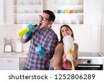 happy young couple doing chores ... | Shutterstock . vector #1252806289