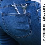 wrenches in the back pocket of... | Shutterstock . vector #1252812550