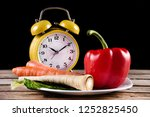 vegetables on a plate and retro ... | Shutterstock . vector #1252825450