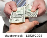 human hands exchanging money  ... | Shutterstock . vector #125292026