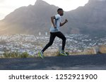 fit athletic male jogger runs... | Shutterstock . vector #1252921900