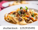 idalian pasta pappardelle with... | Shutterstock . vector #1252935490