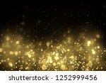 sparkling golden dust  glowing... | Shutterstock .eps vector #1252999456