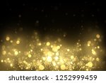 sparkling golden dust  glowing... | Shutterstock .eps vector #1252999459
