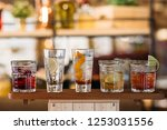 five different cocktails on the ... | Shutterstock . vector #1253031556