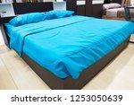 closeup modern bed   stylish... | Shutterstock . vector #1253050639
