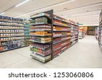 Small photo of ROME, ITALY. December 05, 2018: Lanes of shelves with goods products inside a MA supermarket in Italy in Rome. Variety of preserves and pasta. Shelves full and tidy.