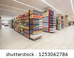 Small photo of ROME, ITALY. December 05, 2018: Lanes of shelves with goods products inside a MA supermarket in Italy in Rome. Variety of packaged foods. Shelves full and tidy.