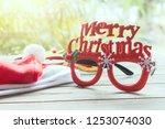 merry chrismas eyes glassess on ... | Shutterstock . vector #1253074030